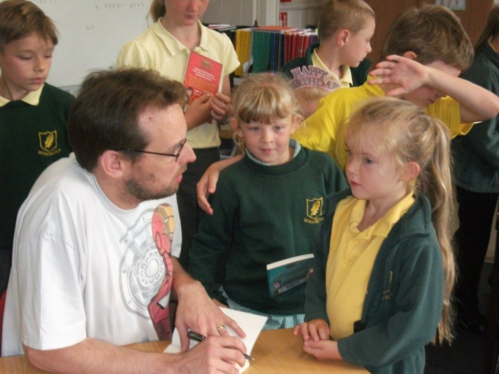 Dan signing books at a school